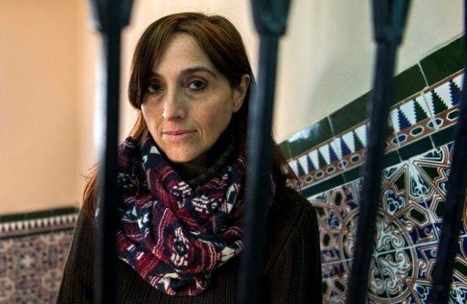 أ ف ب  |الناشطة هيلينا مالينو لدى تصويرها أمام منزلها في طنجة في 9 كانون الثاني/يناير 2018