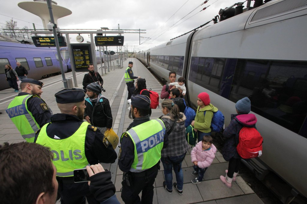 Swedish police gather a group of migrants off an incoming train at the Swedish end of the bridge between Sweden and Denmark, Malmo, Sweden                         EPA/STIG-AKE