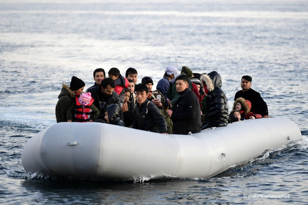 Migrants on a rubber dinghy shortly before reaching Greek shores at Skala Sikaminias on the island of Lesbos after having crossed over from Turkey March 2 2020  Photo Picture-alliance
