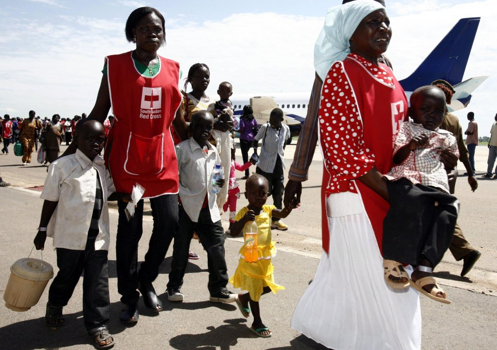 Stranded South Sudanese at Kosti Port, arriving at the airport in Juba, South Sudan. (Credit: EPA)