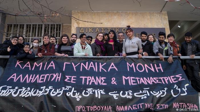 "Support for Gabi and Natasha is strong: The banner reads: ""No woman alone, solidarity to  trans people and migrant women"""