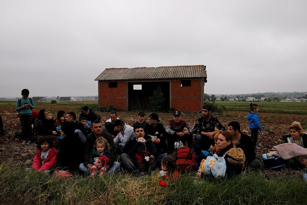 Migrants gathered near the Evros River, on the Greek-Turkish border Photo: Reuters