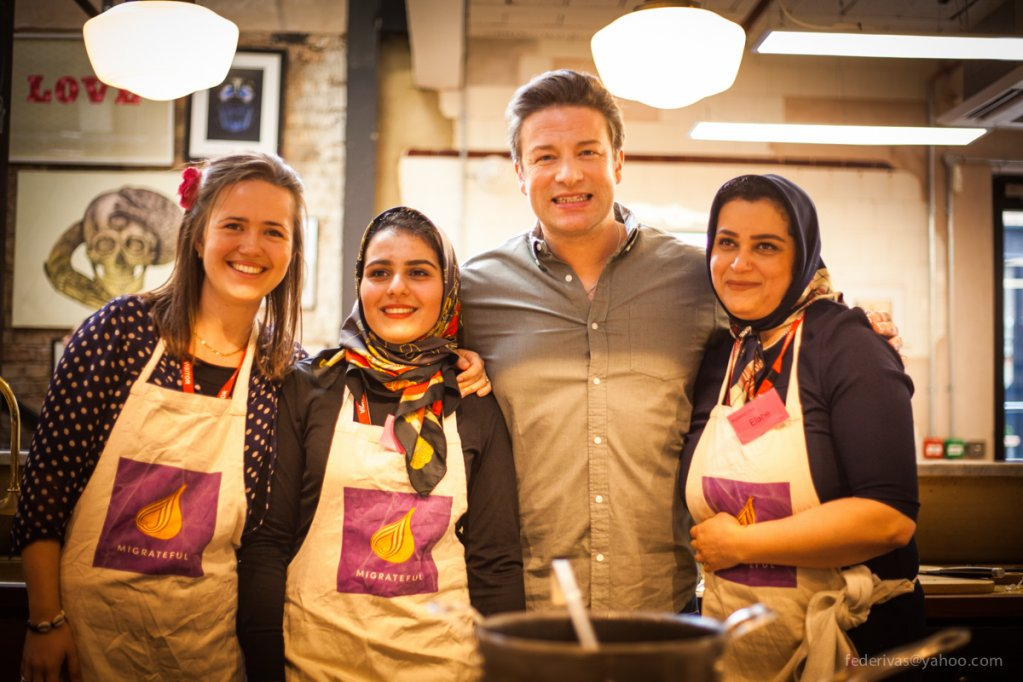 Jess Thompson founder of Migrateful alongside celebrity chef Jamie Oliver and Iranian mother and daughter Migrateful chefs Elahe and Parastoo  Photo with kind permission of Migrateful