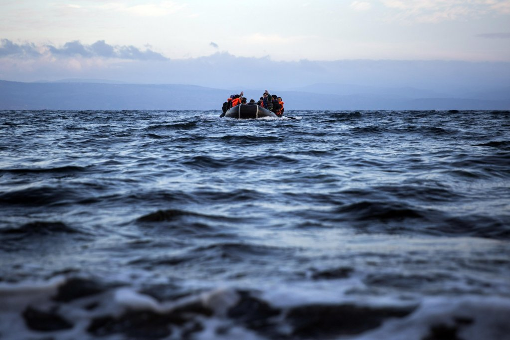 Migrants on a dinghy approach the coast of the Greek island of Lesbos. Credit: ANSA/AP Photo/ Santi Palacios