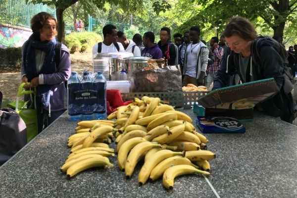 Every Friday Paul a neighborhood retiree brings eight to ten kilos of bananas for teenagers Credits InfoMigrants