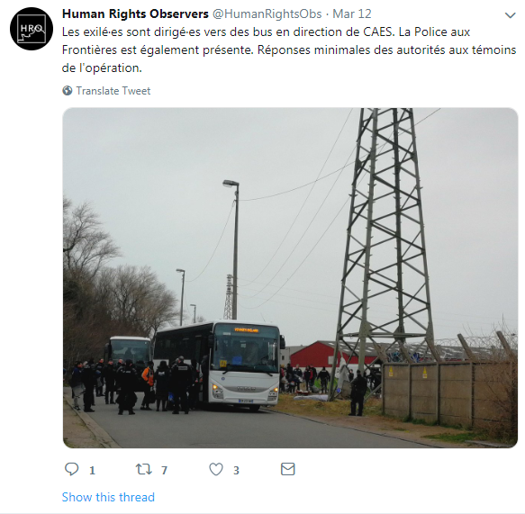 A bus taking migrants to other welcome centers at the Verrotiéres camp in Calais which was dismantled on Tuesday 12 March | Photo: Screenshot: Twitter / Human Rights Obs
