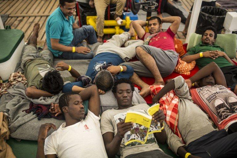 OLMO CALVO / AFP |Des migrants à bord du navire humanitaire de l'ONG Open-Arms, le 1er juillet 2018.