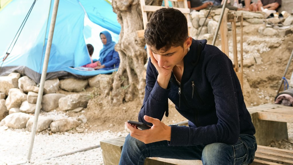 Young Afghan migrant on Lesbos  Photo Aasim Saleem