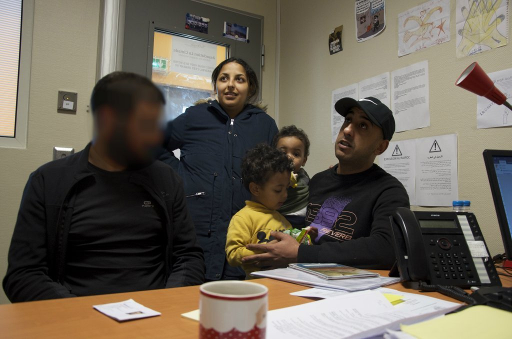 Mehdi Arafe and Hakim Bendjedai explain their situation to Senator Rachid Temal in the office of The Cimade at the CRA in Mesnil-Amelot Friday April 26 Mehdi Arafes face was blurred at his request Credit Mava Poulet  InfoMigrants