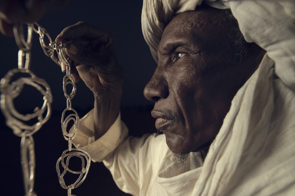 Sidi, a refugee jeweller shows off one of his designs for MADE51 | Photo: UNHCR for Made 51 / 6M productions