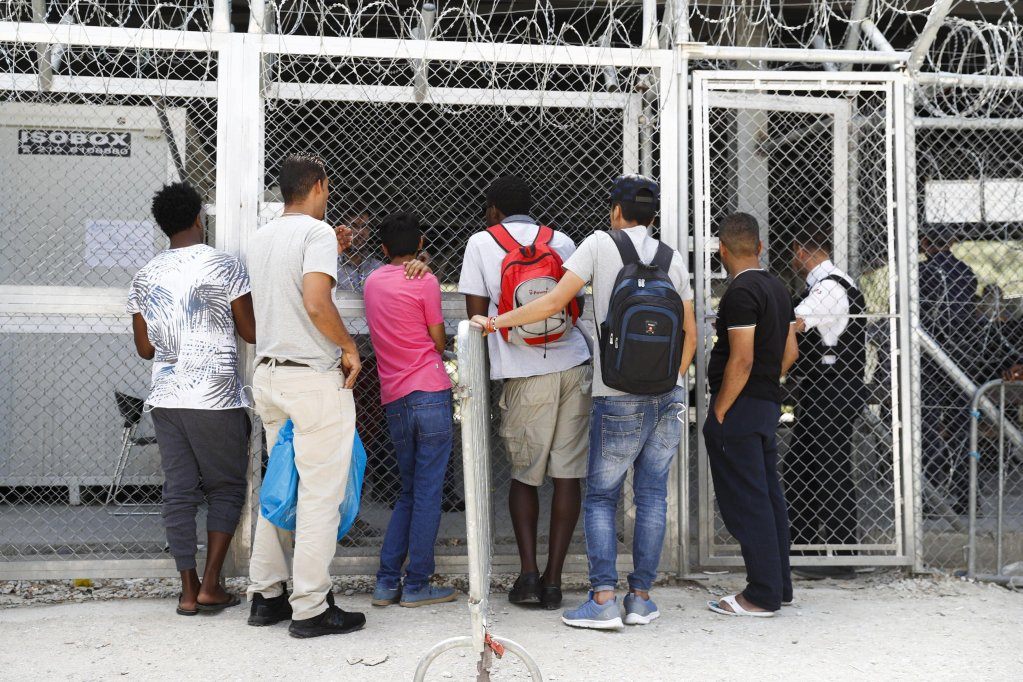 Refugees wait to enter the registration office in the Moria refuge camp, on the island of Lesbos in Greece, 22 May 2017. Swiss Federal Councilor Simonetta Sommarug visits the refugee camps Moria and Kara Tepe, as well as the capital Athens. EPA/PETER KLAUNZER