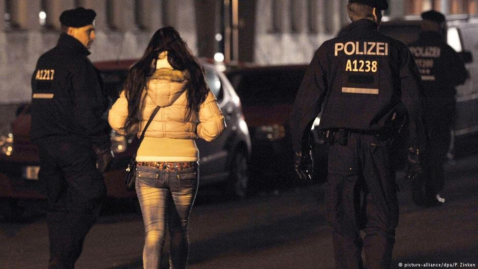 Police escort a woman working as a prostitute during a raid in Berlin  Photo Picture-alliancedpaPZinken