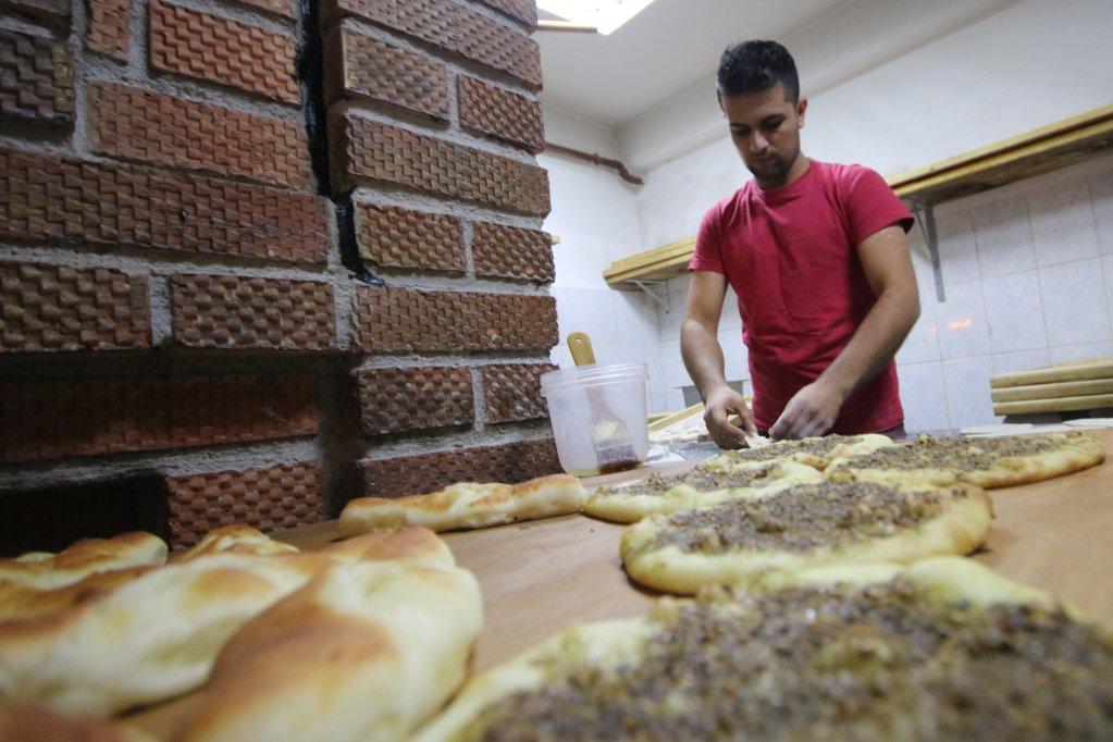 Mustafa baking pies. Photo: Cristian Stefanescu