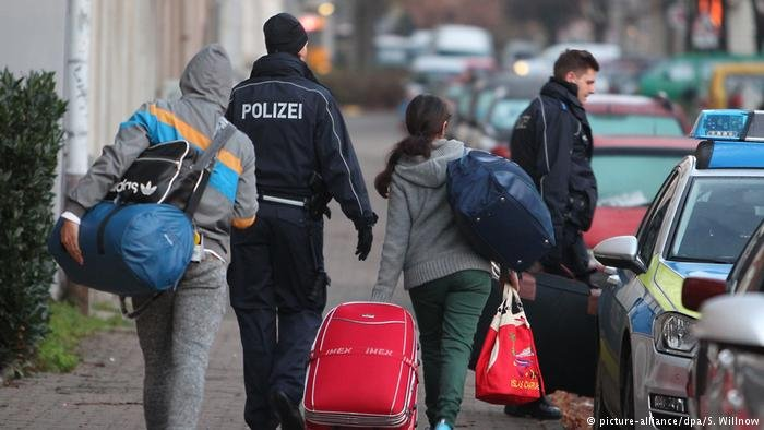 rejected asylum-seekers are escorted by police in Leipzig to the airport