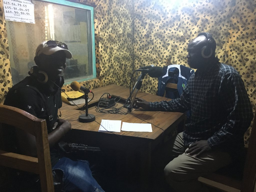 Journalists at Mamou's rural radio station regularly hosts programmes on the dangers of illegal immigration. Photo: Julia Dumont