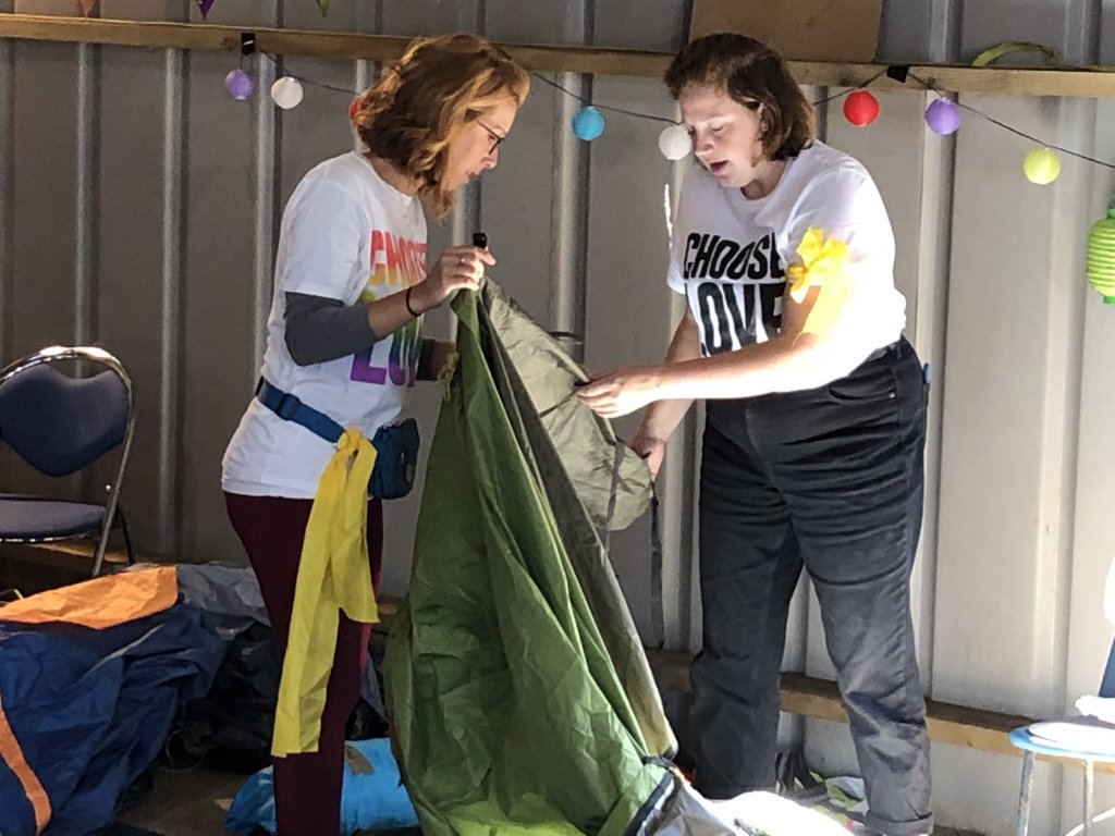 Sol Escobar and a fellow volunteer salvaging discarded tents in September 2019 in Cambridge for use in Calais  Photo Courtesy of Sol Escobar