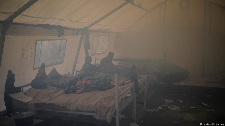Two men in a smoke-filled tent  Photo ReutersM Djurica