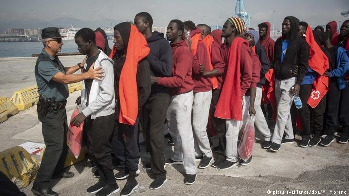 Migrants arriving at a port in Spain