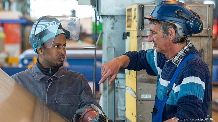 Hamza Ahmed from Somalia works for a company that produces steel parts for wind turbines