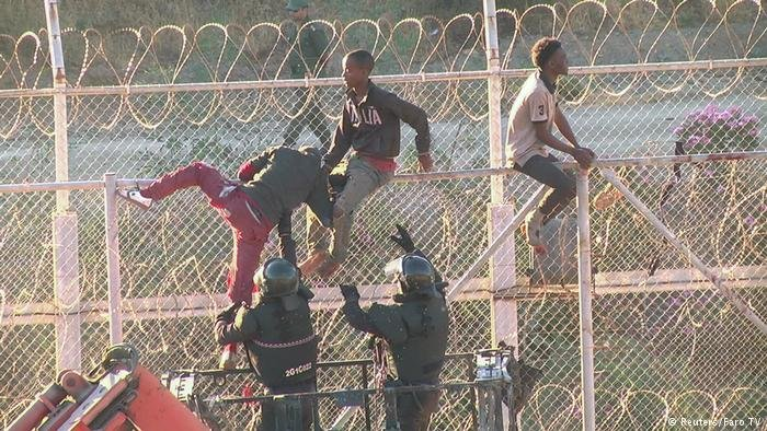 African migrants seen climbing the border between Morocco and Spain's North African enclace Ceuta