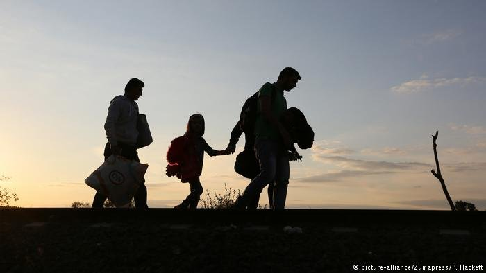 Migrants cross the border from Hungary to Serbia