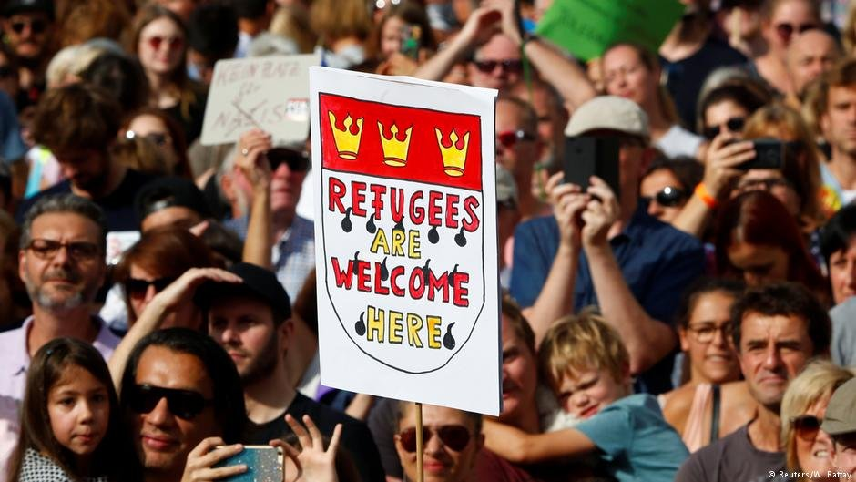 This 'Refugees are welcome' poster bears the Cologne coat of arms