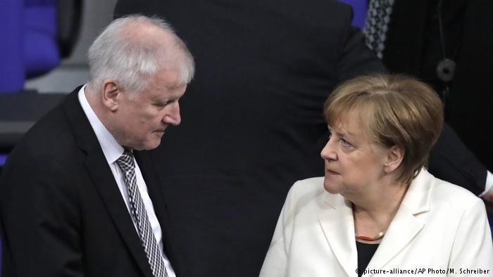 German Interior Minister Horst Seehofer and Chancellor Angela Merkel | Credit: picture-alliance/AP photo/m. Schreiber