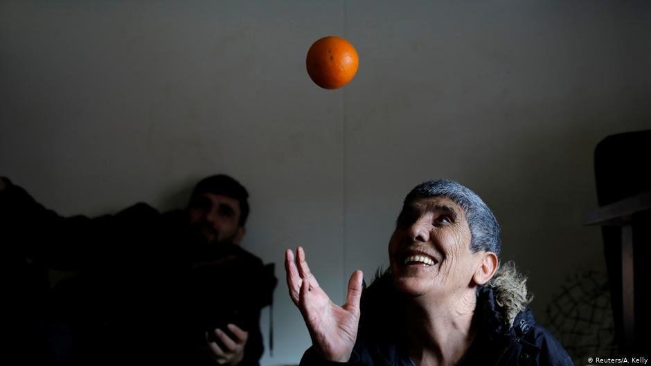Karim Azizi, 55, from Iran throws an orange in his room at Kaershovedgaard | Photo: Reuters/A.Kelly