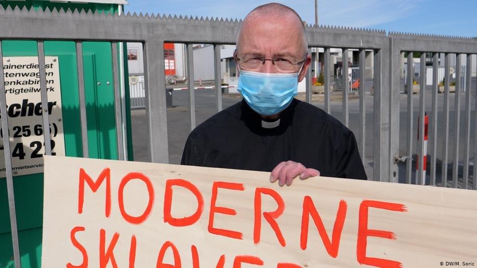 Patrick Peter Kossen holds up a sign reading end modern slavery  Photo DWMSoric