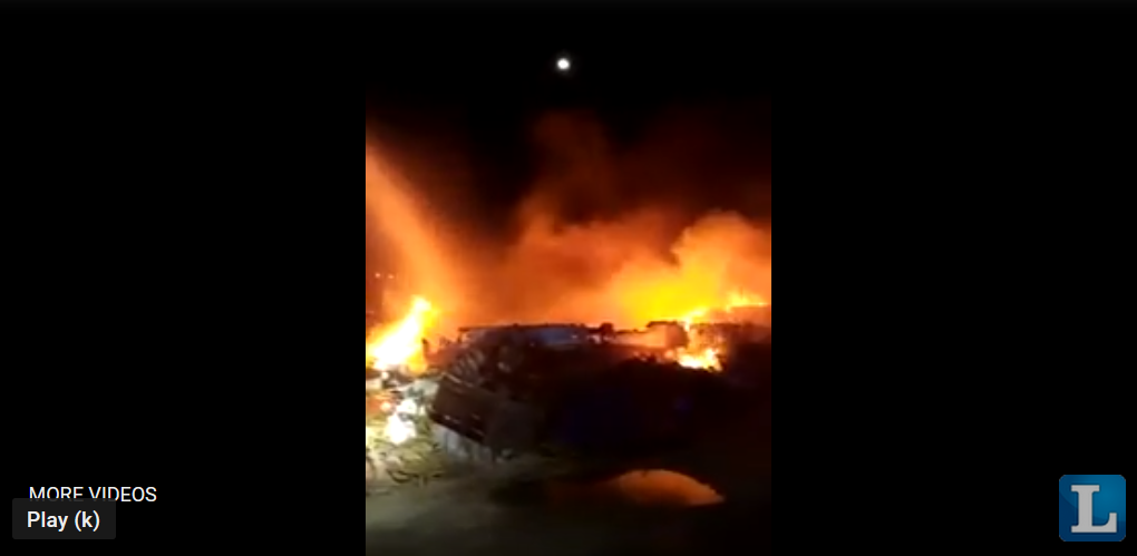 A screenshot of the fire in the migrant boat graveyard on Lampedusa on Friday June 5  Source Screenshot of video on La Sicilia website