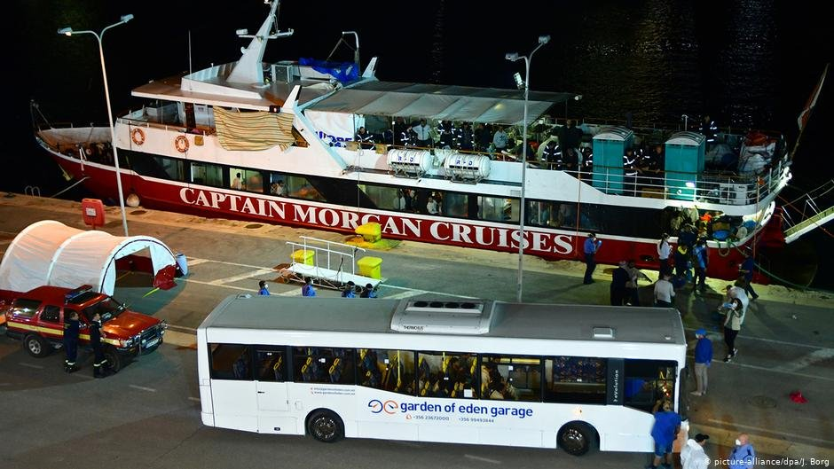 A bus awaits the migrants on board the Captain Morgan Cruises boats  Photo  Picture-alliancedpaJBorg
