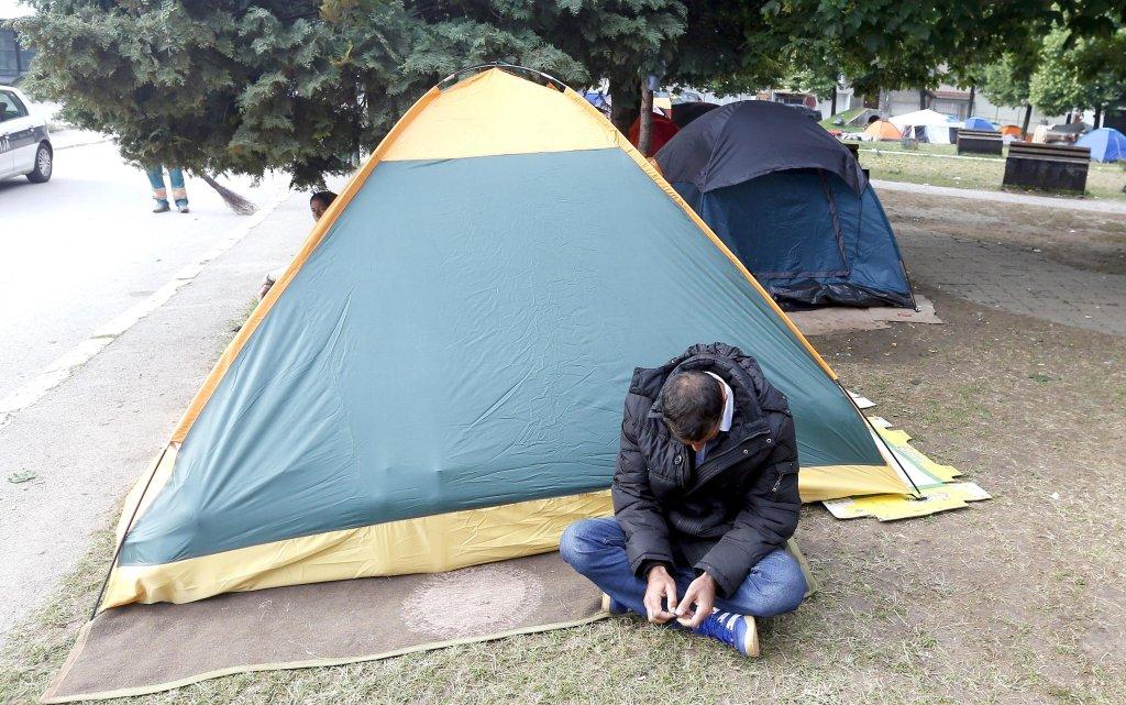 A migrant camps in a park in Sarajevo, Bosnia   Credit: EPA/FEHIM DEMIR
