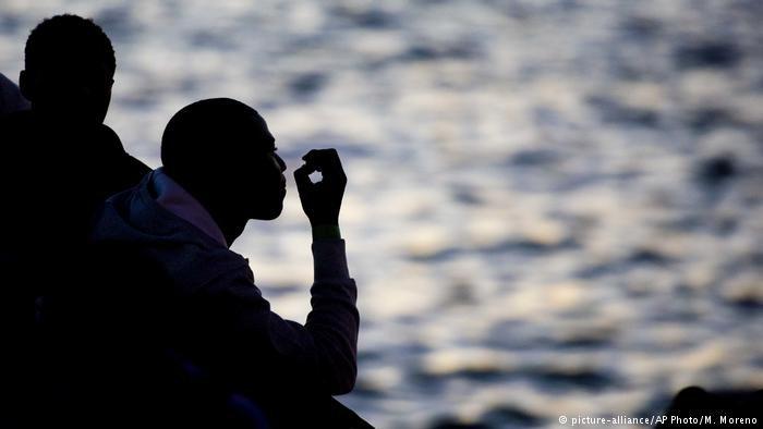 Silhouette of migrants aboard rescue ship