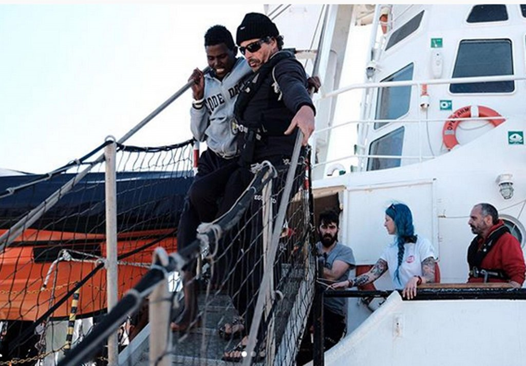 migrants disembarking from Open Arms ship, where the young man was traveling. Credit: PROACTIVA/ANSA