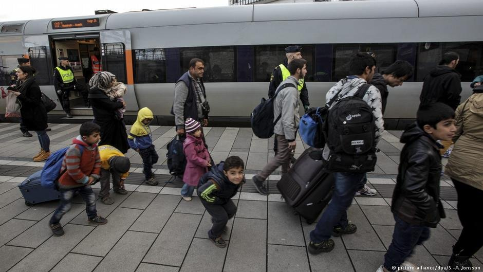 A group of migrants arrives off a train in Malmo Sweden in November 2015
