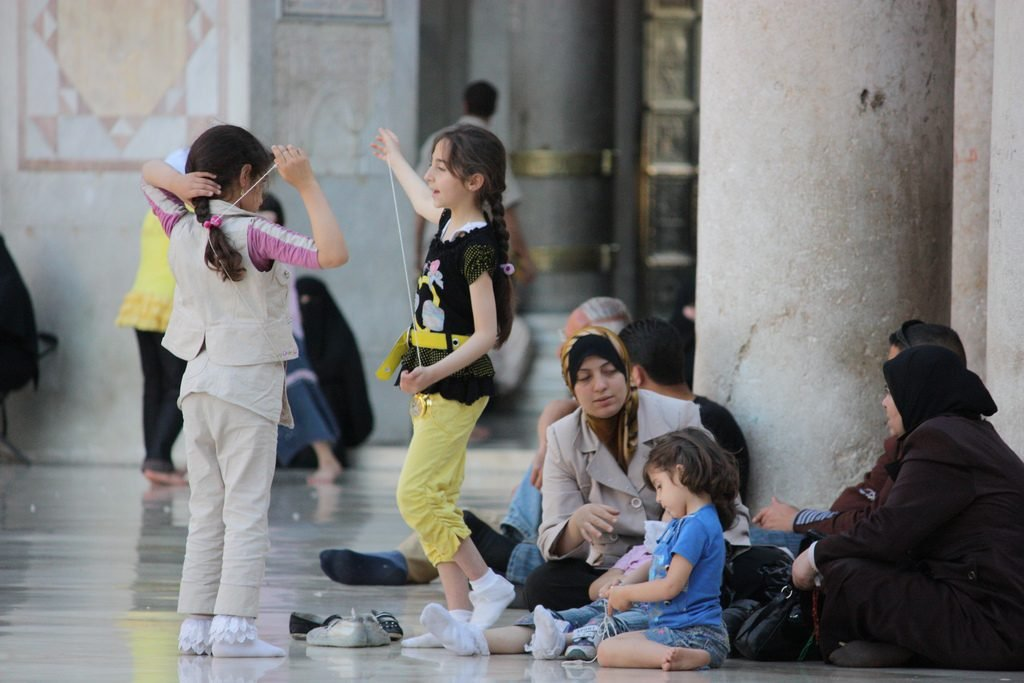 Little girls playing at the Umayyad Mosque in Damascus. Copyright: Arlan Zwegers/Creative Commons