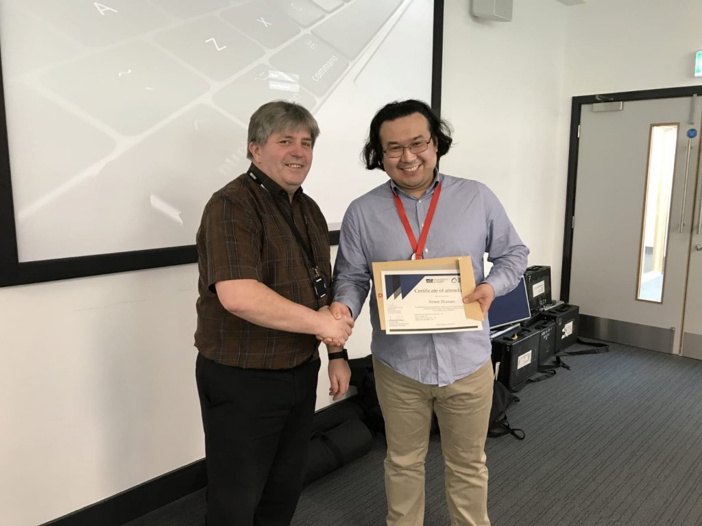 Ernest Zhanaev is handed his certificate in UK journalism by the head of the journalism school at the University of Derby Keith Perch  Photo Private