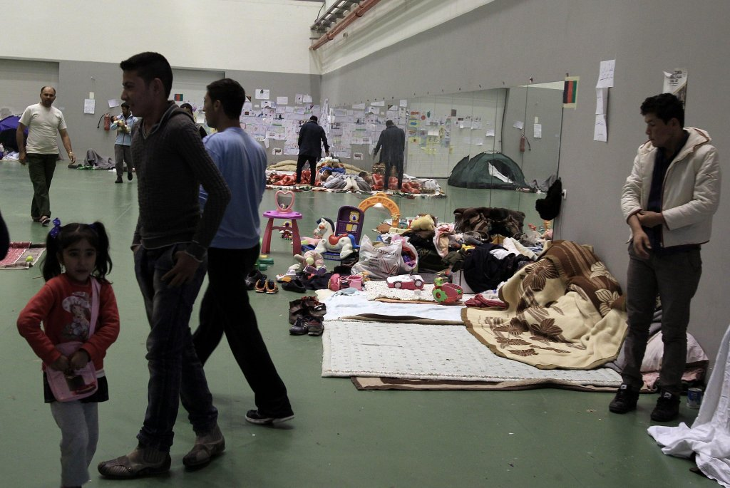 From file: Refugees rest on blankets inside the Galatsi Olympic Hall in Athens (ANSA)