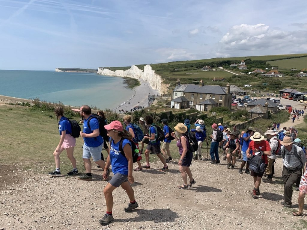 Walkers walk the British coast at Birling Gap  Credit With kind permission of Refugee Tales