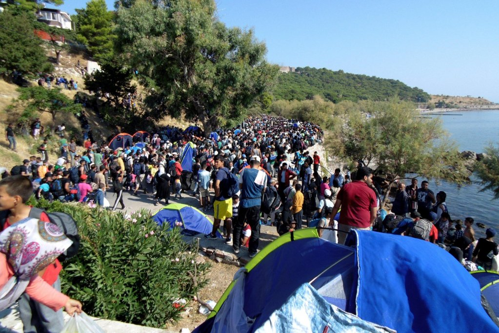 Picture shows migrants and refugees at the port of Lesvos island, Greece. EPA (archive)