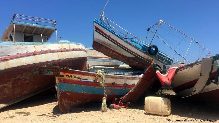 Migrant boats in a pile on the Italian island of Lampedusa