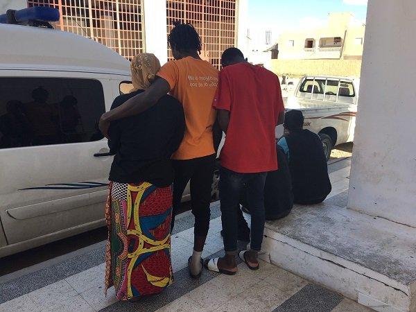 Quelques migrants du foyer posent devant le btiment Crdit  InfoMigrants