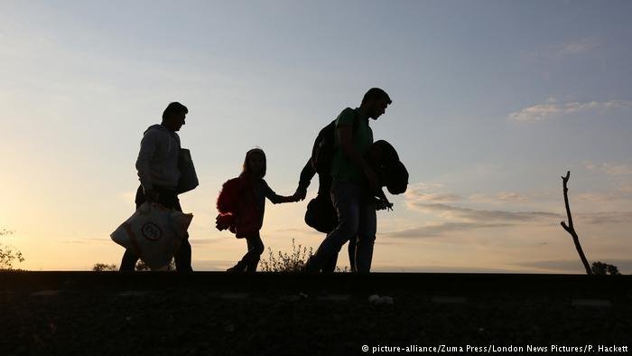 Shilouette of a migrant family in Hungary