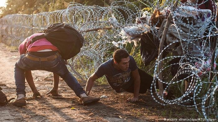 Migrants crossing the border between Hungary and Serbia