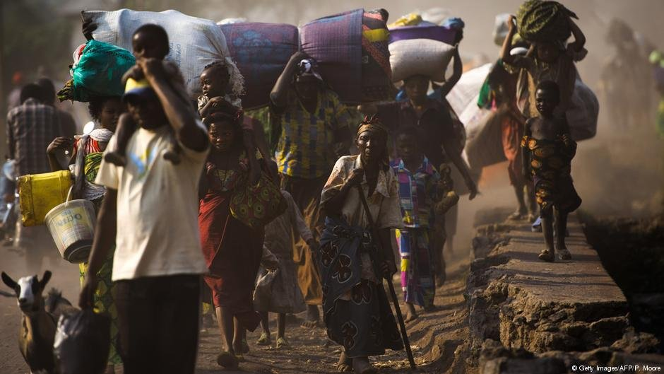 A group of people fleeing conflict in Goma in DR Congo with their belongings  Photo Getty ImagesAFPPMoore