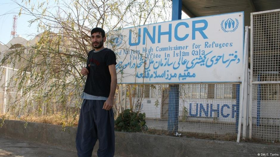 Ahmad in front of the UNHCR office in Islam Qala