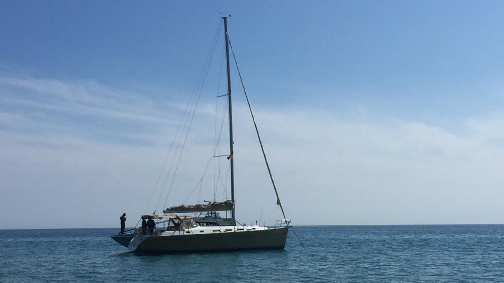 A sailboat that a group of migrants used to reach the beach at Calopezzati, in the province of Cosenza, Calabria | PHOTO: ANSA