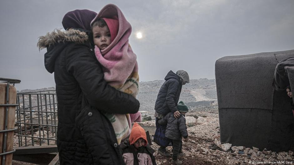 Syrian families are seen at a camp in Turmanin near the Turkish border on a cold winter day in Idlib Syria on February 14 2020  Photo Picture-allianceAAMSaid