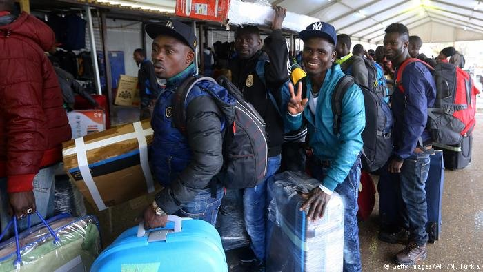 African immigrants from Ivory Coast at an airport in Tripoli, Libya