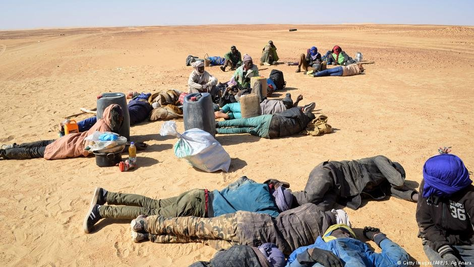 A group of migrant men rest in the desert during their journey in northern Niger  Photo Getty ImagesAFPS Ag Anara